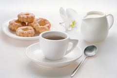 Early morning breakfast with coffee and pastry on a white background. Life style stock photography