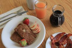 Early morning breakfast of juices, meats, fruit and fried oatmeal Royalty Free Stock Photography