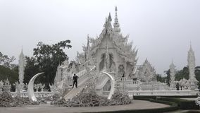 Early morning at the Buddhist temple Wat Rong Khun White temple. Chiang Rai