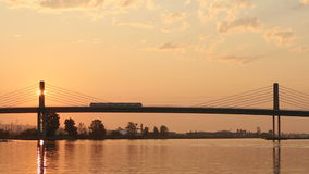 Early Morning Canada Line Bridge and Train. The new Canada Line, a rapid transit commuter train, crosses the Fraser River from Richmond and the airport into stock video footage