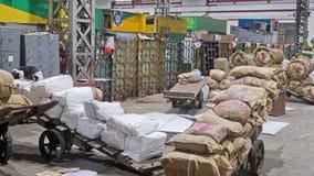 Early morning cargoes in Mumbai. MUMBAI,  INDIA - OCTOBER 27, 2016: Cargo for loading on early morning trains at Victoria railway terminus  Chhatrapati Shivaji Stock Image