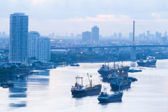 Early morning on chaophraya river Bangkok Thailand. Early morning on Chaophraya river in Bangkok Thailand with many commercial ships standing Stock Photos