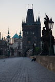 Early morning on Charles Bridge. Early morning scenery with sitting man on Charles bridge Stock Photography