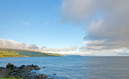 Early morning clouds on a sea coast stock image