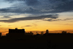 Early morning cloudscape with silhouette of building Stock Images
