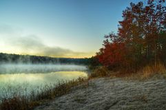 Early morning colors and fog. Cold air, fog on the lake and frost on the ground! This was the picture I was hoping I'd get while waiting on sunset Royalty Free Stock Image