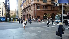 Pedestrians Crossing Street in Martin Place, Sydney CBD, Australia. Early morning commuters and shoppers crossing a Sydney CBD street, Martin Place pedestrian stock video