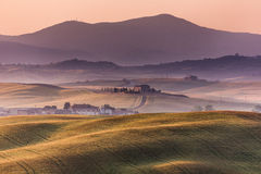 Early morning on countryside, San Quirico d´Orcia, Tuscany, Ita Stock Photography
