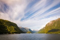 Early Morning Cruise across Lake Manapouri. On a adventure ride to the remote Doubtful Sound in Fiordland National Park, New Zealand, South Island Stock Photography