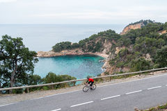 Early Morning Cycling. Road Cycling on the coastal highway Royalty Free Stock Photography