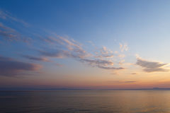 Early morning at dawn of the day with a calm blue sea overlookin Stock Photography