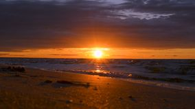 Early morning dawn or late evening dusk sunset sunrise on sea ocean shore. Epic dramatic vibrant red sunset sunrise with heavy rainy clouds on calm Baltic sea stock video