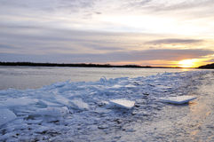 Early Morning at the Dnieper river with a pile of broken ice. Nature, Ukraine.Dnieper river in winter with a pile of broken ice pieces on the river bank stock photography