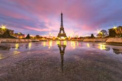 Early morning Eiffel tower reflection on the empty fountain