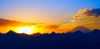 Early morning Elbrus. Raising sun beams illuminating an Elbrus mountainside royalty free stock photo