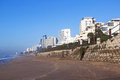Early Morning Empty Beach and Concrete Retaining Wall Royalty Free Stock Photography
