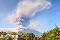 Fuego volcano erupting, near Antigua, Guatemala. Early morning eruption of Fuego volcano next to Acatenango volcano near Antigua, Guatemala, Central America royalty free stock photography