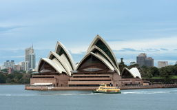 Early morning ferry past Sydney Opera House Royalty Free Stock Photo