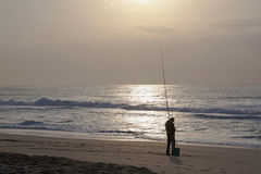 Early Morning Fisherman on Durban's Blue Lagoon Beach Royalty Free Stock Images
