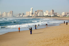 Early Morning Fishermen on Durban Beach with Hotels in Backgroun Stock Photo