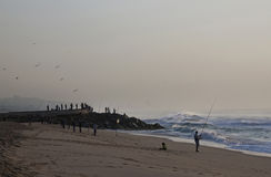 Early Morning Fishermen on Durban's Blue Lagoon Beach Royalty Free Stock Image