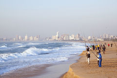 Early Morning Fishermen at Durban's Blue Lagoon Beach Royalty Free Stock Photography