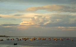 Early Morning Fishing. Fishing boats gather for the day of fishing in the morning light along the coast in Vietnam Royalty Free Stock Image