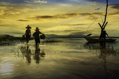 Early morning fishing boat ,Fishermen and kid fishing in the ear Royalty Free Stock Photography