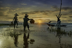 Early morning fishing boat ,Fishermen and kid fishing in the ear Stock Photography