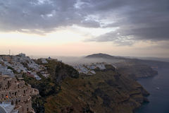Early morning fog above Santorini and sunrise Stock Image