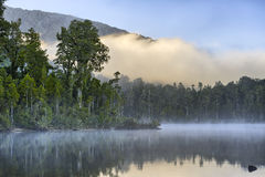 Early morning fog at Lake Kaniere. New Zealand stock images