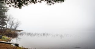 Early morning fog on a lake near Ottawa, Ontario. Stock Image