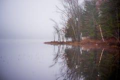 Early morning fog on a lake near Ottawa, Ontario. Stock Photos