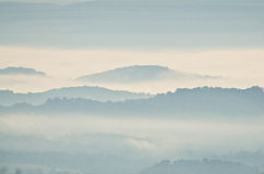 Early Morning Fog in the Mountains Stock Photos