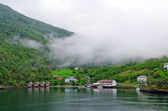 Early morning fog in a Norwegian Village Stock Images