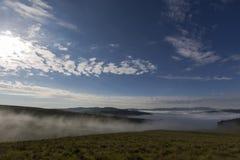 Early morning fog rising. Drakensberg South Africa royalty free stock photo