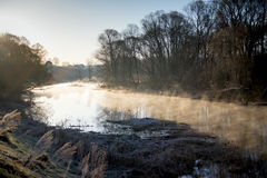 Early morning fog on a river Stock Photo