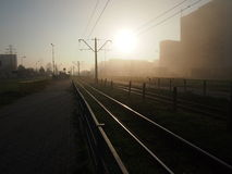 Early morning with fog. Morning fog with shiny railroad royalty free stock photos