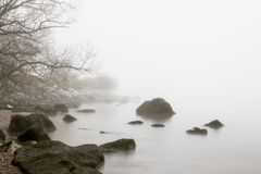 Early morning fog at the shore. A foggy morning in the fall at the ocean shore Royalty Free Stock Images