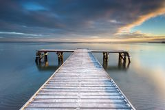 Early morning at frozen small pier in Sopot. Royalty Free Stock Images