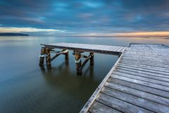 Early morning at frozen small pier in Sopot. Royalty Free Stock Photos