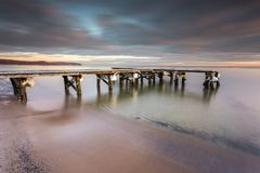Early morning at frozen small pier in Sopot. Royalty Free Stock Photo