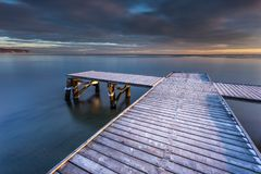 Early morning at frozen small pier in Sopot. Royalty Free Stock Image