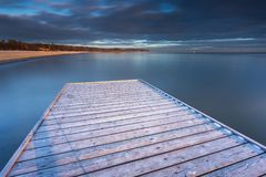 Early morning at frozen small pier in Sopot. Stock Photography
