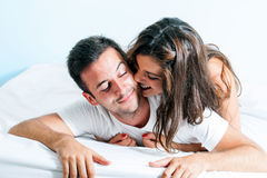 Early morning fun in bedroom. Royalty Free Stock Photos