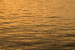Early morning gentle sea. Early morning gentle orange sea in horizontal composition Royalty Free Stock Images