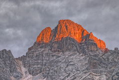Early morning glow on Croda Rossa. In the Italian Dolomites Royalty Free Stock Photo