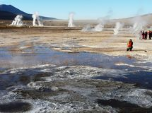Tourists on the high mountain field of El Tatio geysers royalty free stock images