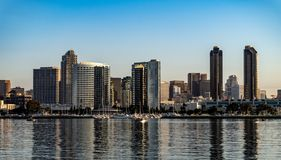 Early morning harbor view from Coronado Island, California. Early morning harbor skyline view from Coronado Island near San Diego, California with clear, blue stock image