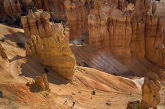 Early morning hikers begin down the trail from Sunset Point in Bryce Canyon National Park. stock photography